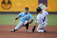 Ian Dawkins (17) of the Winston-Salem Dash slides into second base ahead of the tag by Hickory Crawdads shortstop Frainyer Chavez (5) at Truist Stadium on July 10, 2021 in Winston-Salem, North Carolina. (Brian Westerholt/Four Seam Images)