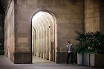 © Joel Goodman - 07973 332324 . Manchester , UK . 05/04/2015 . A man urinates in a corner , against Manchester Town Hall . Revellers on a Saturday night out during the Easter Bank Holiday weekend . Photo credit : Joel Goodman