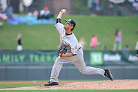 Starting pircher Luis Cedeno (5) of the Charleston RiverDogs delivers a pitch in a game against the Greenville Drive on Tuesday May 17, 2016, at Fluor Field at the West End in Greenville, South Carolina. Greenville won, 4-2. (Tom Priddy/Four Seam Images)