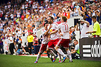Brandon Barklage (25) of the New York Red Bulls celebrates scoring with teammates. The New York Red Bulls defeated DC United 3-2 during a Major League Soccer (MLS) match at Red Bull Arena in Harrison, NJ, on June 24, 2012.