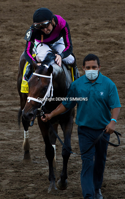 Art Collector, ridden by jockey Brian Hernandez Jr., celebrate after winning the Runhappy Ellis Park Derby's 10th race for a $200,000 purse at Ellis Park in Henderson, Ky., Sunday afternoon, Aug. 9, 2020. Art Collector won the race handily. The race is a qualifier for the upcoming Sept. 5, 2020, Kentucky Derby, with 85 points (50-20-10-5) up for grabs.