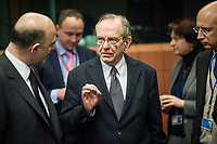 Pierre Moscovici , EU commissioner for Economic and financial affairs, taxation and customs union (L) and Pier Carlo Padoan, Italian Minister for Economy and Finances   at the start of a Eurogroup with European Finance Ministers meeting at EU council headquarters in Brussels, Belgium on 26.01.2015 The Eurogroup's meeting focus on Greece, after  leftist anti-bailout party SYRIZA won parliamentary elections by Wiktor Dabkowski