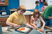 Making pizza, Summerhill School, Leiston, Suffolk. The school was founded by A.S.Neill in 1921 and is run on democratic lines with each person, adult or child, having an equal say.  You don't have to go to lessons if you don't want to but could play all day.  It gets above average GCSE exam results.