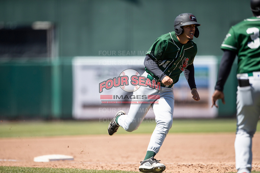 Great Lakes Loons third baseman Miguel Vargas (11) rounds third base on May 30, 2021 against the Lansing Lugnuts at Jackson Field in Lansing, Michigan. (Andrew Woolley/Four Seam Images)