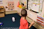 Preschool ages 3-5 two boys playing imaginary baseball pretend play horizontal