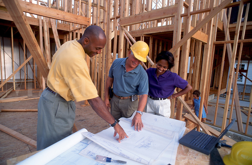 Family and builder during home construction<br />