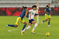 ORLANDO, FL - JANUARY 22: Alana Cook #28 dribbles away from the pressure by Kena Romero #9 during a game between Colombia and USWNT at Exploria stadium on January 22, 2021 in Orlando, Florida.