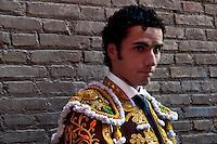 A young Spanish bullfighter (matador) enters the bullring in Granada, Spain, 7 June 2006.