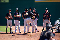 Modesto Nuts pitchers Sam Delaplane (28), Kyle Wilcox (30), Joey Garber (12), and Scott Boches (33) watch starting pitcher Ian McKinney (31) warm up before a California League game against the Inland Empire 66ers on April 10, 2019 at San Manuel Stadium in San Bernardino, California. Inland Empire defeated Modesto 5-4 in 13 innings. (Zachary Lucy/Four Seam Images)