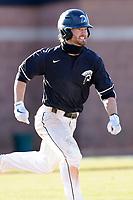 Cameron MacIntosh (8) of the University of South Carolina Upstate Spartans runs out a batted ball in a game against the University of Toledo Rockets on Saturday, February 20, 2021, at Cleveland S. Harley Park in Spartanburg, South Carolina. Upstate won, 5-1. (Tom Priddy/Four Seam Images)