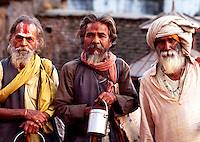 Portrait of three Hindi men wearing traditional beards, clothing and facial ornamentation. Kathmandu, India.