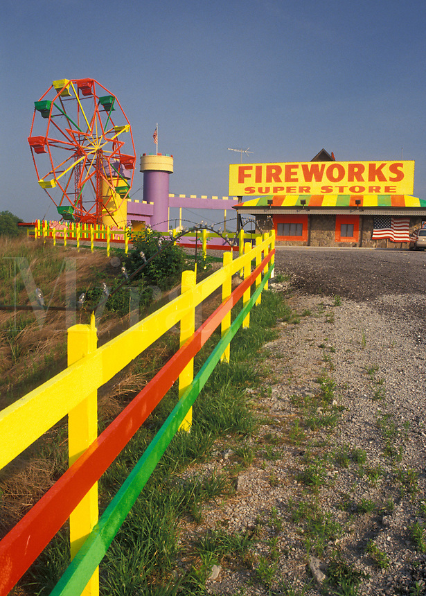 fireworks, ferris wheel, TN, Tennessee, A yellow, red, and green fence leads up to the yellow, red, and green ferris wheel at the Fireworks Super Store of the interstate in Tennessee.