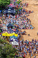 A huge crowd of spectators on the beach watch the 2016 Big Wave Eddie Aikau Contest, Waimea Bay, North Shore, O'ahu.