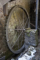 """Switzerland. Canton Ticino. Aranno forge. The """"Sentiero delle Meraviglie"""" is a walking path. Water as a source of energy has been used since antiquity, with the water mill as perhaps the best-know application. Its use, however, in driving a forge, is much less common. Metal wheel and stone walls. The """"Sentiero delle Meraviglie"""" is a guided trail which is plunged into nature, but every so often signs of human activity appear. Aranno is located in the Malcantone area. 16.03.2010 © 2010 Didier Ruef"""