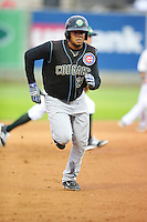 Jeimer Canderlario #27 of the Kane County Cougars runs to third base against the Clinton LumberKings at Ashford University Field on July 5, 2014 in Clinton, Iowa. The Cougars won 4-0.   (Dennis Hubbard/Four Seam Images)