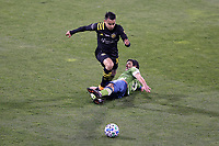 COLUMBUS, OH - DECEMBER 12: Lucas Zelarayan #10 of the Columbus Crew is fouled by Nicolas Lodeiro #10 of the Seattle Sounders FC during a game between Seattle Sounders FC and Columbus Crew at MAPFRE Stadium on December 12, 2020 in Columbus, Ohio.
