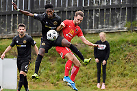 Nathanael Hailemariam of Team Wellington competes for the ball with Cory Mitchell of Canterbury United during the ISPS Handa Men's Premiership - Team Wellington v Canterbury Utd at David Farrington Park, Wellington on Saturday 19 December 2020.<br /> Copyright photo: Masanori Udagawa /  www.photosport.nz