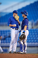 Dunedin Blue Jays relief pitcher Jonathan Cheshire (18) talks with catcher Alberto Mineo (44) on the mound during a game against the Jupiter Hammerheads on August 14, 2018 at Dunedin Stadium in Dunedin, Florida.  Jupiter defeated Dunedin 5-4 in 10 innings.  (Mike Janes/Four Seam Images)