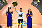 Egan Bernal (COL) Team Ineos wins the young riders White Jersey on the final podium at the end of Stage 21 of the 2019 Tour de France running 128km from Rambouillet to Paris Champs-Elysees, France. 28th July 2019.<br /> Picture: ASO/Pauline Ballet   Cyclefile<br /> All photos usage must carry mandatory copyright credit (© Cyclefile   ASO/Pauline Ballet)