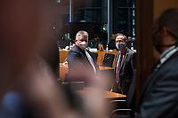 """107. Sitzung des """"1. Untersuchungsausschuss"""" der 19. Legislaturperiode des Deutschen Bundestag am Donnerstag den 5. November 2020 zur Aufklaerung des Terroranschlag durch den islamistischen Terroristen Anis Amri auf den Weihnachtsmarkt am Berliner Breitscheidplatz im Dezember 2016.<br /> Als Zeugen waren unter anderem der Praesident des Bundeskriminalamtes, Holger Muench, der Praesident des Bundesnachrichtendienstes Dr. Bruno Kahl, ein nichtoeffentlicher Zeuge des Bundesamt fuer Verfassungsschutz und der Rechtsextremist und Pegida-Gruender Lutz Bachmann geladen.<br /> Im Bild: Im Bild: Der Ausschussvorsitzende Klaus-Dieter Groehler (re.) spricht im Sitzungssaal mit Bruno Kahl (li.) vor der Zeugenvernehmung.<br /> 5.11.2020, Berlin<br /> Copyright: Christian-Ditsch.de"""
