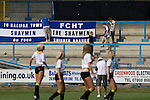 FC Halifax Town 1 Mickleover Sports 1, 23/04/2011. The Shay, Northern Premier League. Supporters putting up a banner behind a group of cheerleaders dancing on the pitch at The Shay, home of FC Halifax Town, on the day that they were presented with the Northern Premier League Premier Division championship trophy following their match with Mickleover Sports. The club replaced Halifax Town A.F.C. who went into administration during the 2007–08 season, having previously been members of the Football League for 80 years. Their promotion meant they would play in Conference North in the 2011-12 season. Photo by Colin McPherson.