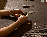 April 16, 2019. Southern Pines, North Carolina.<br /> <br /> Jake Nelson assembles a folding knife at Spartan Blades. <br /> <br /> Spartan Blades and Southern Pines Brewing Company are owned by veterans of the United States military Special Operations community.