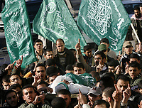 "Gaza.15.01.2008Palestinian Hamas supporters carry the body of Hussam Mahmud Al Zahar, after he was killed during Israeli raid in al Zitun area in the east of Gaza City, 15 January 2008. 16 Hamas militants were killed during an Israeli raid in the east of Gaza City, one of them was Hussam Mahmud al Zahar the son of senior Hamas leader Dr Mahmud al Zahar. ""photo by Fady Adwan"