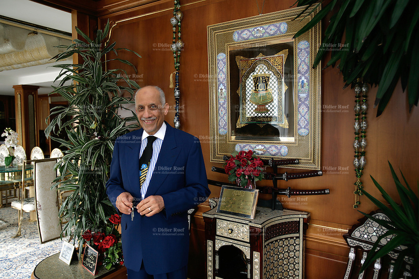 Italy. Province of Como. Campione. Campione is an italian enclave, close to Lugano, and surrended by Switzerland. The Egyptian Youssef Nada, president of the Nada Management, former Al Taqwa, at home in his villa Nada. He stands close to a religious painting with the word Allah written. The open criminal investigation against Youssef Nada, which directed Islamic bank Al-Taqwa of Lugano since its creation in 1988, is now classified. The Swiss Prosecutors office has been forced to drop its criminal case against Youssef Nada and Al Taqwa for its role in financing al Qaeda and terrorism. However Nada, who has denied any ties with terrorism, has admitted being in the past one of the principal leaders of the international branch of the Moslem Brothers. © 2006 Didier Ruef / pixsil