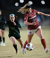 NWA Democrat-Gazette/ANDY SHUPE<br /> Arkansas' Stefani Doyle (17) pushes the ball past North Texas' Madeline Guderian (13) Friday, Nov. 15, 2019, during the first half of play in the first round of the NCAA women's soccer tournament at Razorback Field in Fayetteville. Visit nwadg.com/photos to see more photographs from the match.