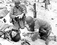 Medics helping injured soldier, France, 1944. (OWI)<br /> Exact Date Shot Unknown<br /> NARA FILE #:  208-YE-22<br /> WAR & CONFLICT #:  909