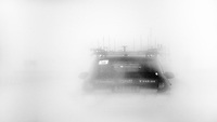 a Team Leopard-Trek teamcar disappearing into icy whiteness<br /> <br /> Milan - San Remo 2013: the iced edition<br /> <br /> ©kramon