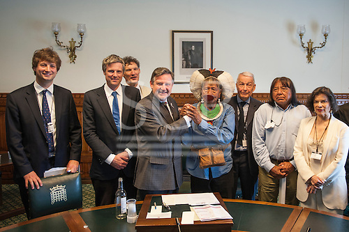 11 June 2014. Kayapo Chiefs Raoni Metuktire and Megaron Txucarramae during their visit to London. The chiefs stand in a group with members of the British House of Commons at the Houses of Parliament in Westminster. Left to right: Edward Davey (Prince's Rainforest Project), Zac Goldsmith MP, Patrick Cunningham (Tribes Alive), Barry Gardiner MP, Chief Raoni, Frank Field MP, Chief Megaron, Bianca Jagger.