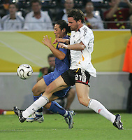 Christoph Metzelder, Mauro Camoranesi.  Italy defeated Germany, 2-0, in overtime in their FIFA World Cup semifinal match at FIFA World Cup Stadium in Dortmund, Germany, July 4, 2006.