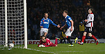 Lewis Macleod celebrates after scoring the second goal for Rangers as keeper Jamie Macdonald watches the ball in the net