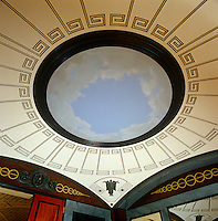 A circluar painted ceiling in the neo-classical style graces a dining room designed in the early 1800s by Sir John Soane