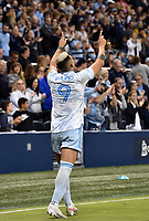 KANSAS CITY, KS - MAY 29: Alan Pulido #9 of Sporting KC celebrates his goal with the crowd during a game between Houston Dynamo and Sporting Kansas City at Children's Mercy Park on May 29, 2021 in Kansas City, Kansas.
