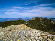 Scenic view of Three Sisters from Mount Chocorua in the New Hampshire White Mountains. The Presidential Range is off in the distance.