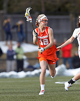 Syracuse University midfielder Katie Webster (18) looks to pass.  Syracuse University (orange) defeated Boston College (white), 17-12, on the Newton Campus Lacrosse Field at Boston College, on March 27, 2013.