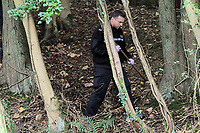 Pictured: Police officers searching for eveidence in the woods where the body of Rebecca Aylward was discovered. Monday 25 October 2010<br /> Re: 15 year old Rebecca Aylward has been found murdered in woodlands near Aberkenfig south Wales. Two fifteen year old men have been arrested. Aylward was originally from nearby Maesteg.