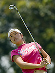 SINGAPORE - MARCH 06:  Angela Park of Brazil watches her tee shot on the 10th hole during the second round of HSBC Women's Champions at the Tanah Merah Country Club on March 6, 2009 in Singapore. Photo by Victor Fraile / The Power of Sport Images