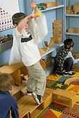 Mr/Schenectady, New York.Yates Arts Magnet School-Pre-Kindergarten.Boy (4) dances at free play time..MR:Gar4.PN#:28913      FC#:23048-00420.scan from slide .© Ellen B. Senisi