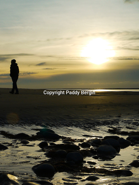 The beach at Ynyslas will always provide beautiful and sometimes dramatic scenes at low tides and sunsets. It is a large expanse of sand dunes and beaches and there is a buried forest which is sometimes exposed at very low tides.<br /> <br /> Stock Photo by Paddy Bergin