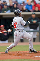Alfredo Silverio #27 of the Great Lakes Loons follows through on his swing versus the Dayton Dragons at Fifth Third Field April 22, 2009 in Dayton, Ohio. (Photo by Brian Westerholt / Four Seam Images)