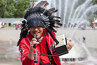 Native American with black feather headdress, singing retro music, NW Folklife Festival, Seattle, WA, USA.