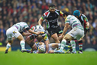 Darren Allinson of London Irish re-sets the ball after being tackled by Chris Robshaw of Harlequins during the Aviva Premiership match between Harlequins and London Irish at Twickenham on Saturday 29th December 2012 (Photo by Rob Munro).