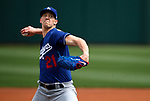 Walker Buehler pitches in a spring training game between the Texas Rangers and Los Angeles Dodgers in Surprise, Ariz., on Sunday, March 7, 2021.<br /> Photo by Cathleen Allison