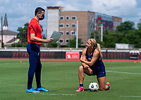 HOUSTON, TX - JUNE 12: Vlatko Andonovski talks with Lindsey Horan #9 of the USWNT before a training session at University of Houston on June 12, 2021 in Houston, Texas.