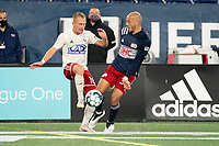 FOXBOROUGH, MA - OCTOBER 16: Tiago Mendonca #33 of New England Revolution II intercepts a pass intended for Derek Waldeck #18 of North Texas SC during a game between North Texas SC and New England Revolution II at Gillette Stadium on October 16, 2020 in Foxborough, Massachusetts.