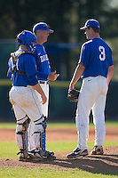 Duke Blue Devils pitching coach Sean Snedeker #33 chats with catcher Matt Williams #18 and pitcher Ryan Knott #3 at Jack Coombs Field March 29, 2009 in Durham, North Carolina. (Photo by Brian Westerholt / Four Seam Images)