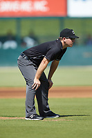 Umpire Brandon Blome handles the calls on the bases during the South Atlantic League game between the Greensboro Grasshoppers and the Kannapolis Intimidators at Kannapolis Intimidators Stadium on August 5, 2018 in Kannapolis, North Carolina. The Intimidators defeated the Grasshoppers 9-0 in game two of a double-header.  (Brian Westerholt/Four Seam Images)
